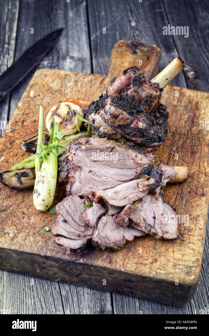 Lamb Knuckle with Vegetable on Cutting Board - Stock Image