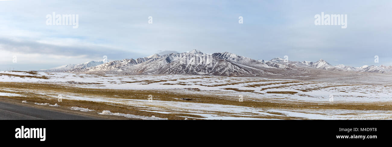 a panoramic view snow mountains on tibet plateau - Stock Image