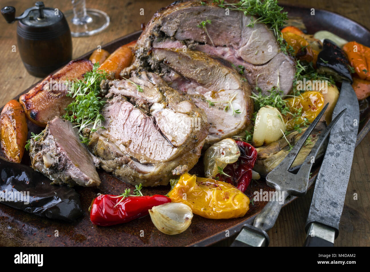 Leg of Lamb with Vegetable and Fruits - Stock Image