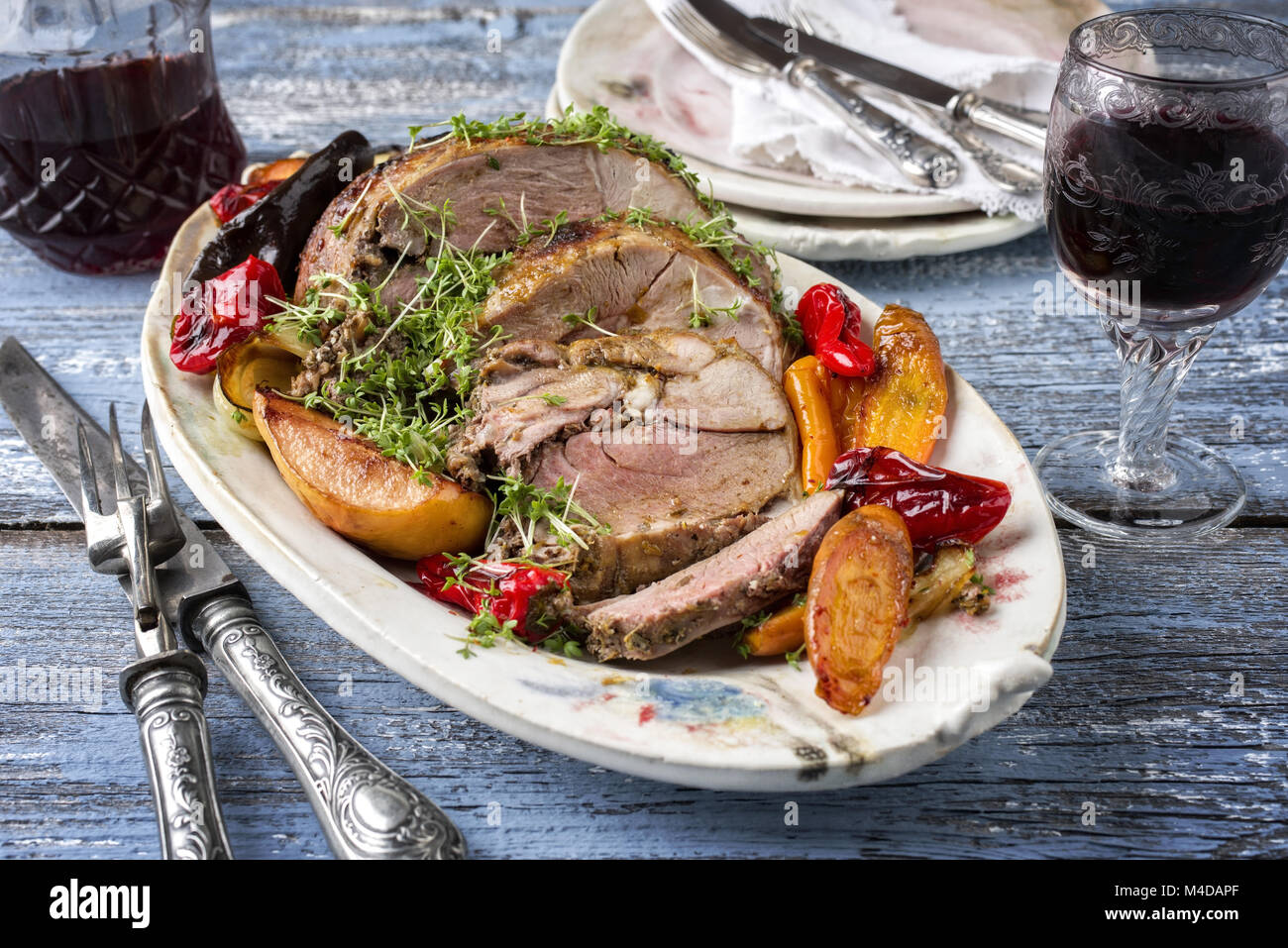 Leg of Lamb with Vegetables and Fruits - Stock Image