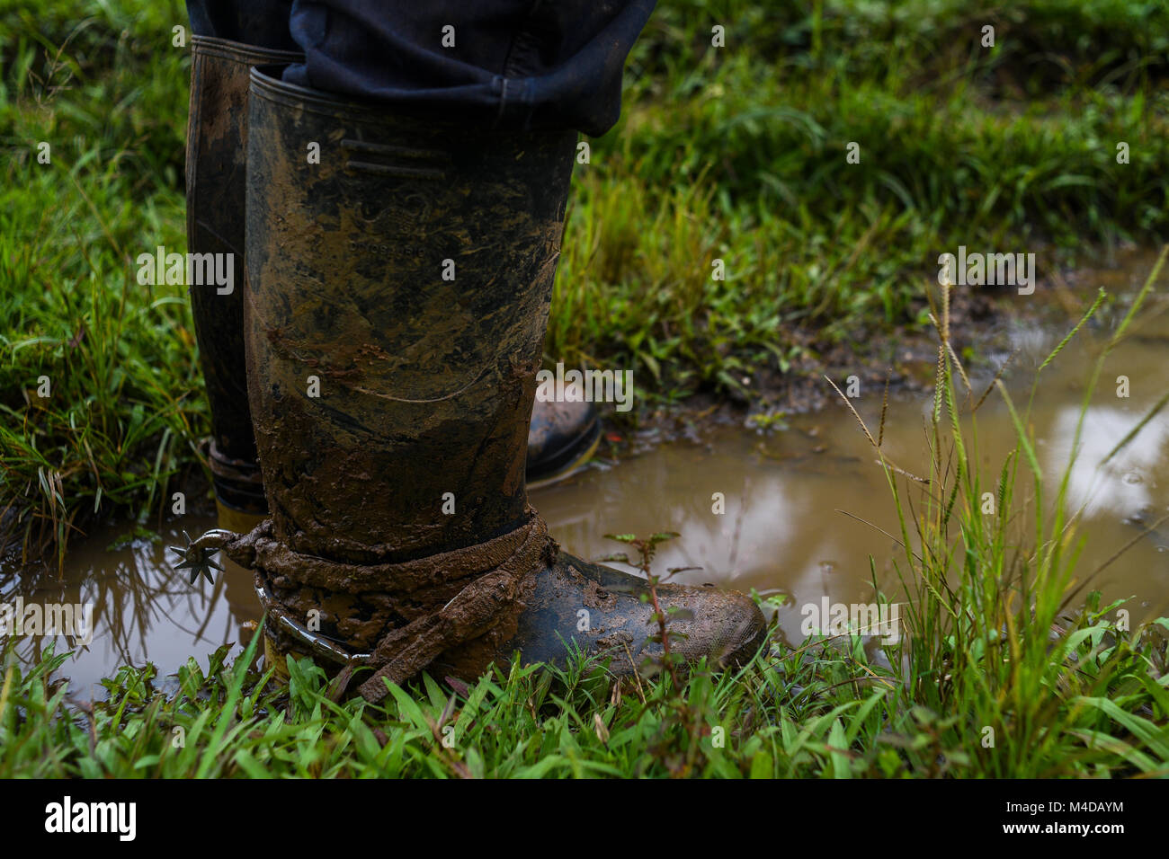 Spurs on a man's boots an indigenous community in rural Nicaragua. - Stock Image