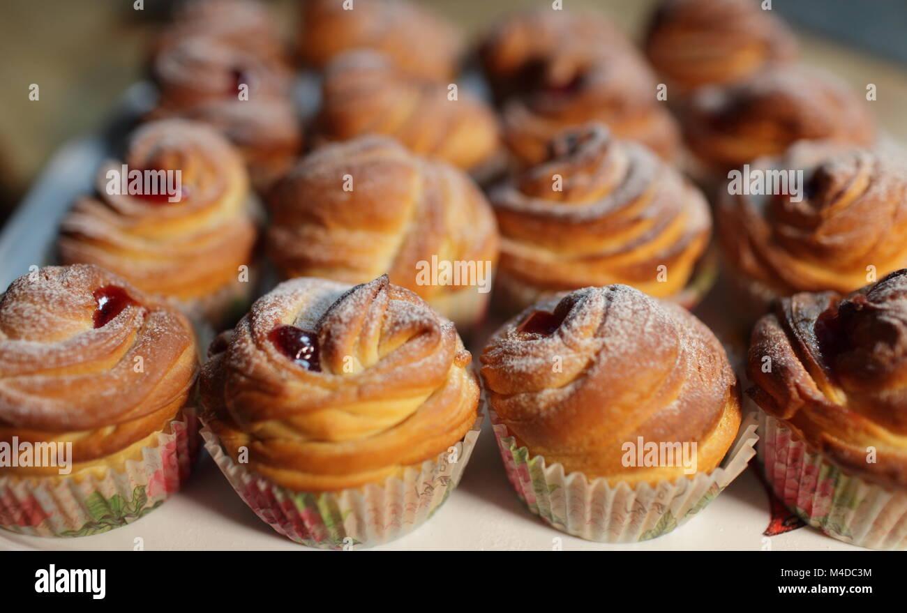 Muffins fresh pastry on baking sheet - Stock Image