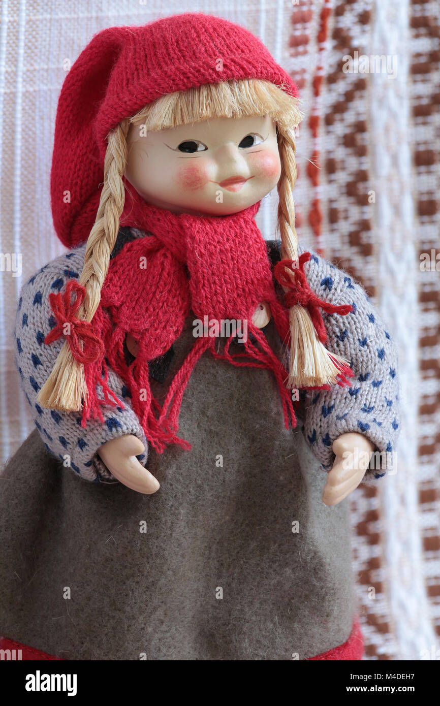 puppet in a red cap with pigtails and red bows - Stock Image