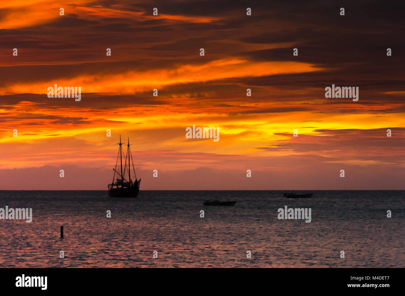 the Golden hour with  sail boats on sea anchored - Stock Image