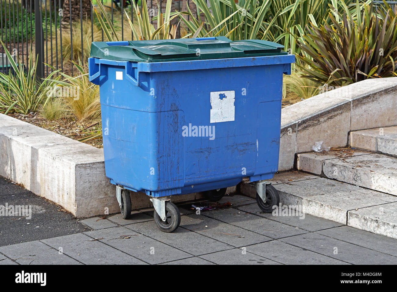 Blue trash can Stock Photo