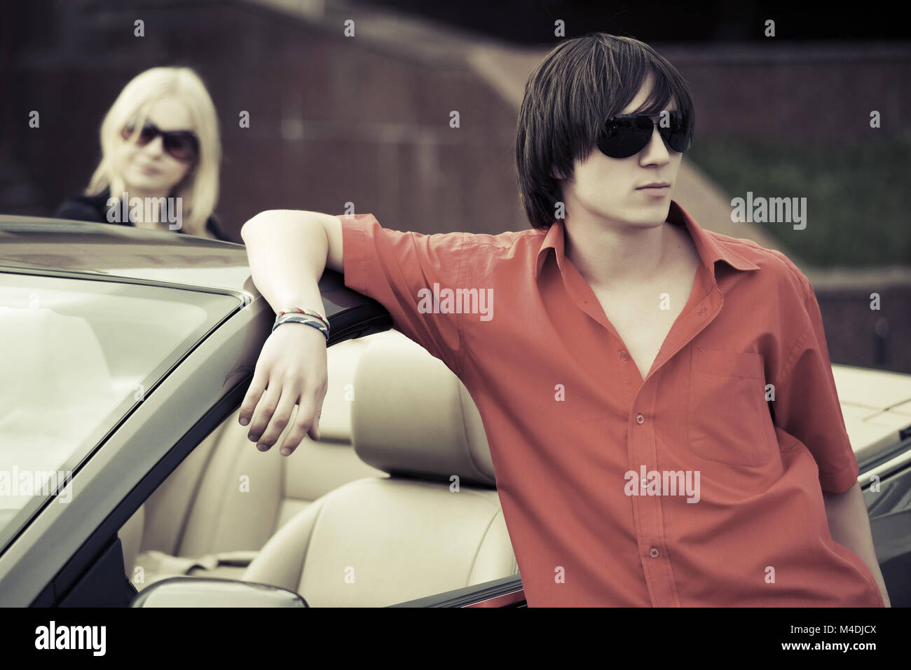 Young fashion couple at the convertible car - Stock Image