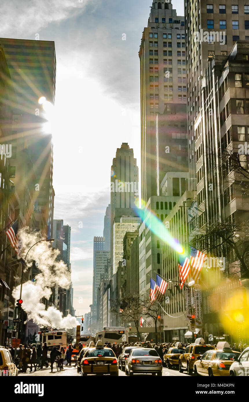 Tourists walking through New York city Avenues - Stock Image