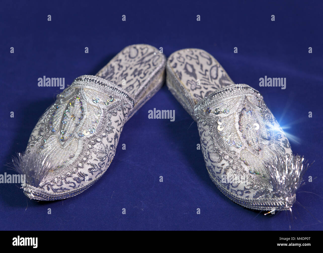 east style bride shoes on a blue velvet - Stock Image
