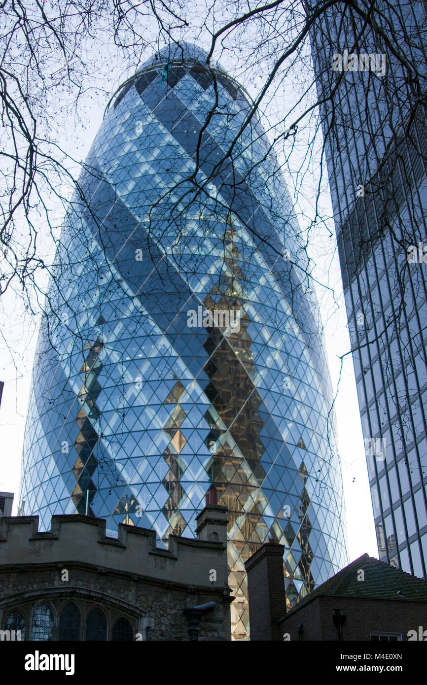 Colour Photograph of The Gherkin, 30 St Mary Axe (informally known as the Gherkin and previously as the Swiss Re - Stock Image
