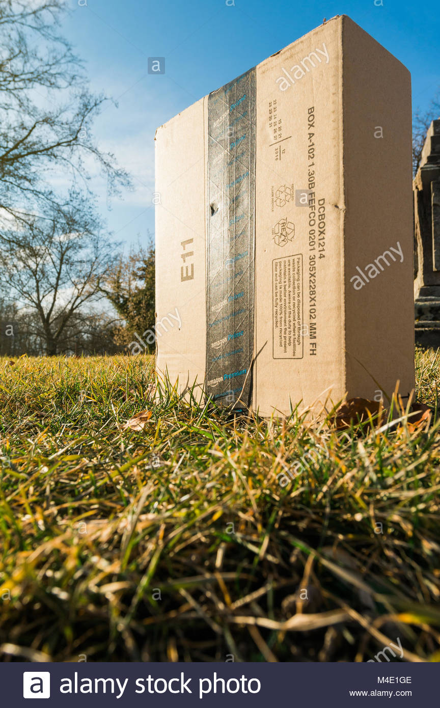 Amazon Prime delivery in park garden by a drone - Stock Image