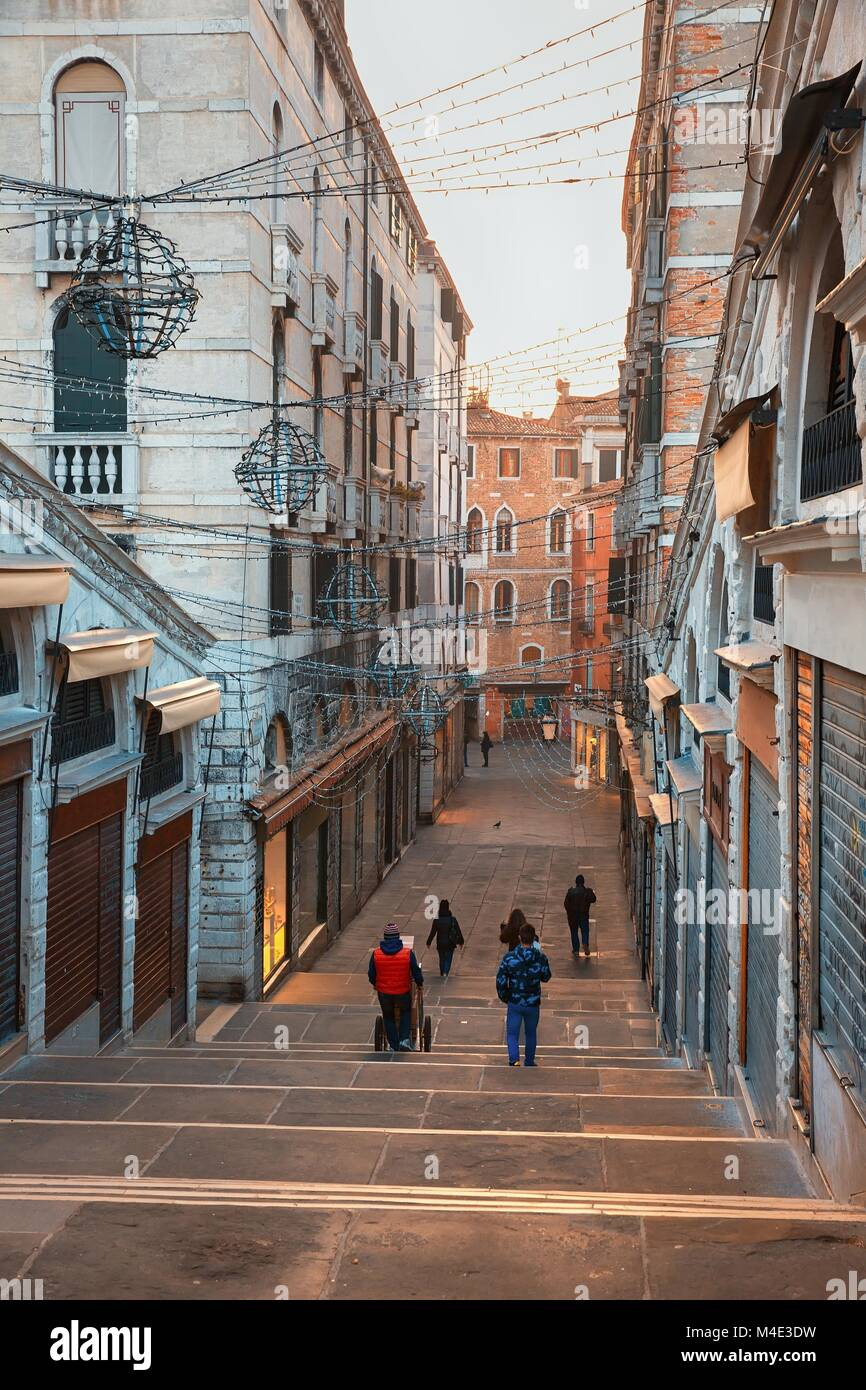 Stairways famous Rialto Bridge in Venice - Stock Image