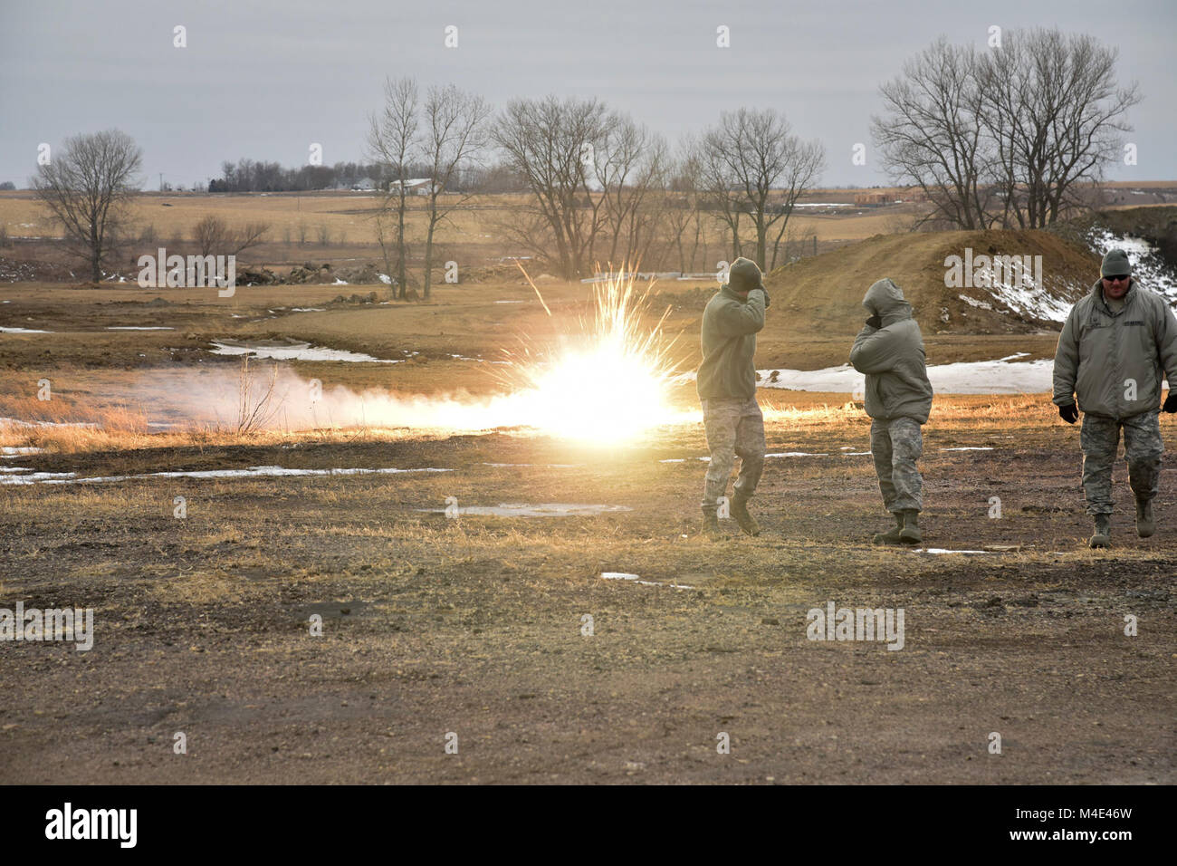 114th Security Forces Squadron members deploy ground burst simulators during training at a range near Joe Foss Field, - Stock Image