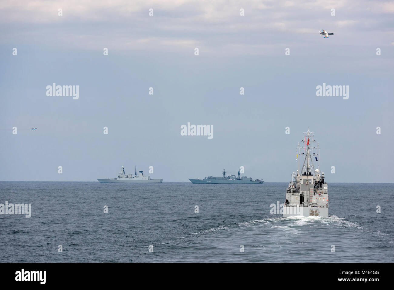 BLACK SEA (Feb 05. 2018) Two Romanian Air Force MiG 21s, fly over NATO vessels (SNMG2 and SNMCMG2) during an Air Stock Photo