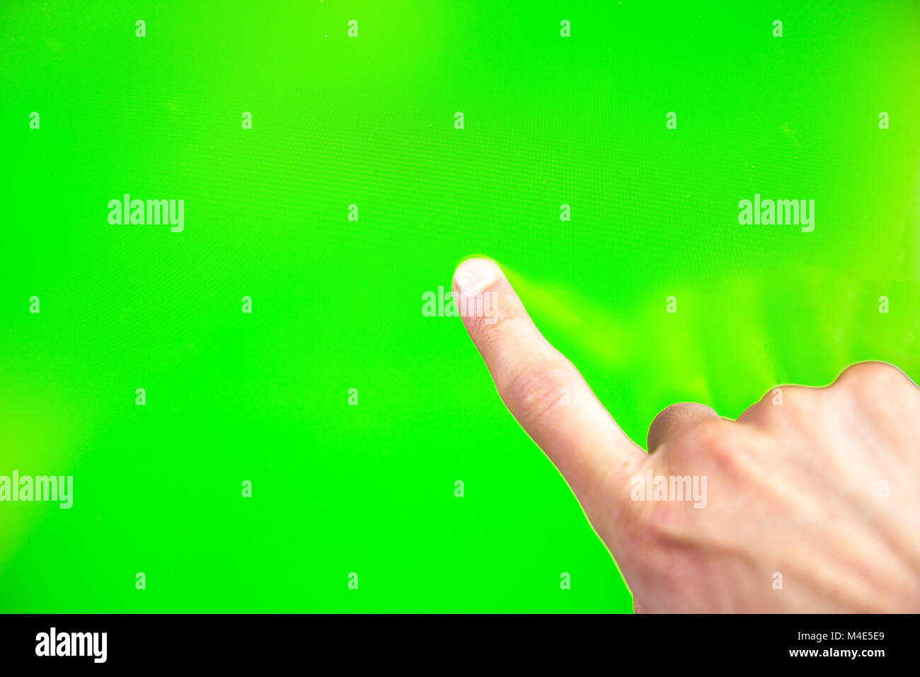 Digital green screen man hand - Stock Image