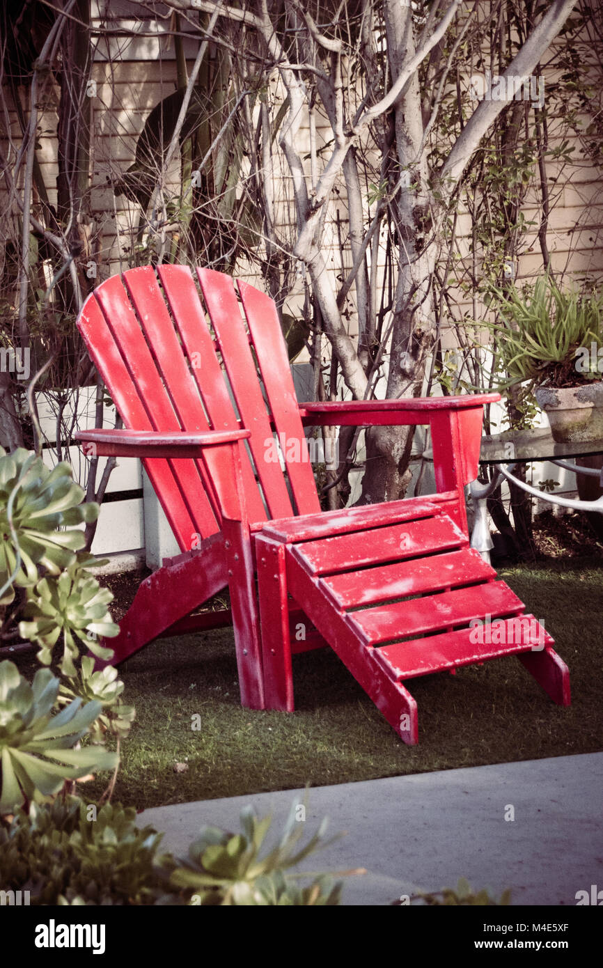 Red Wooden Vintage Beach Chair In The Garden Stock Photo Alamy