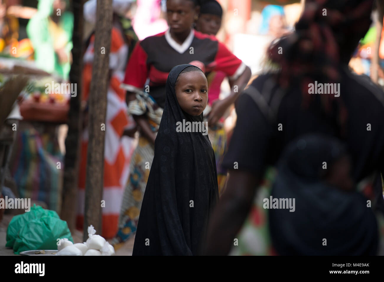 A young ethnic Jola girl at a market place in Senegal, West Africa. - Stock Image
