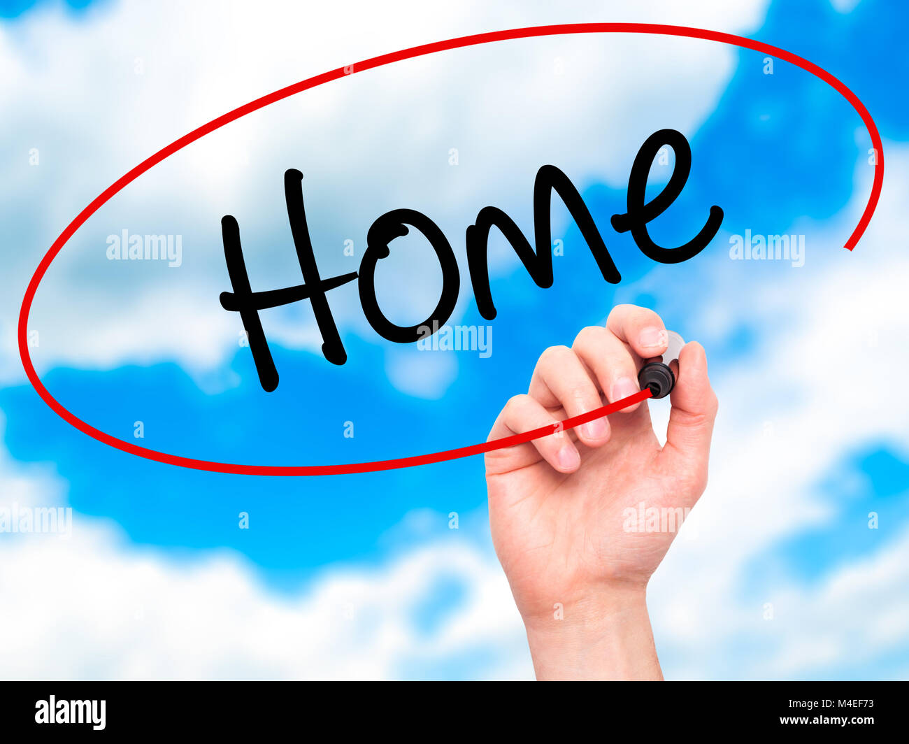 Man Hand writing Home with black marker on visual screen - Stock Image