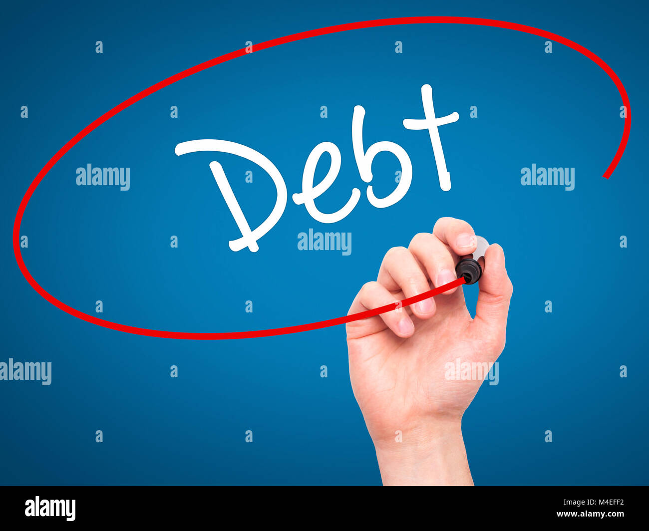 Man Hand writing Debt with black marker on visual screen - Stock Image