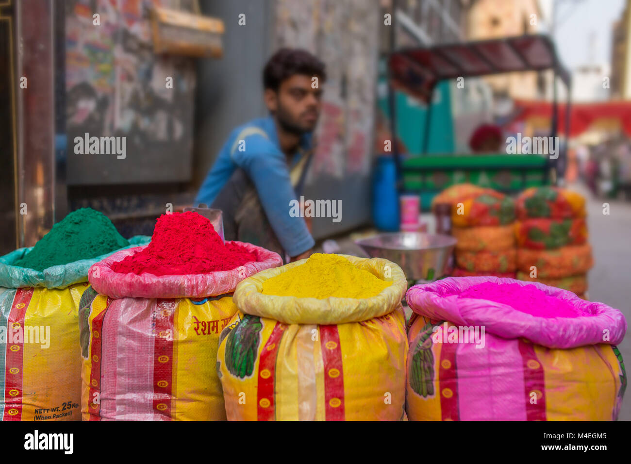 70ece5cfcd Vrindavan, India - March 19, 2016: Unidentified man sell colorful powdered  dyes used