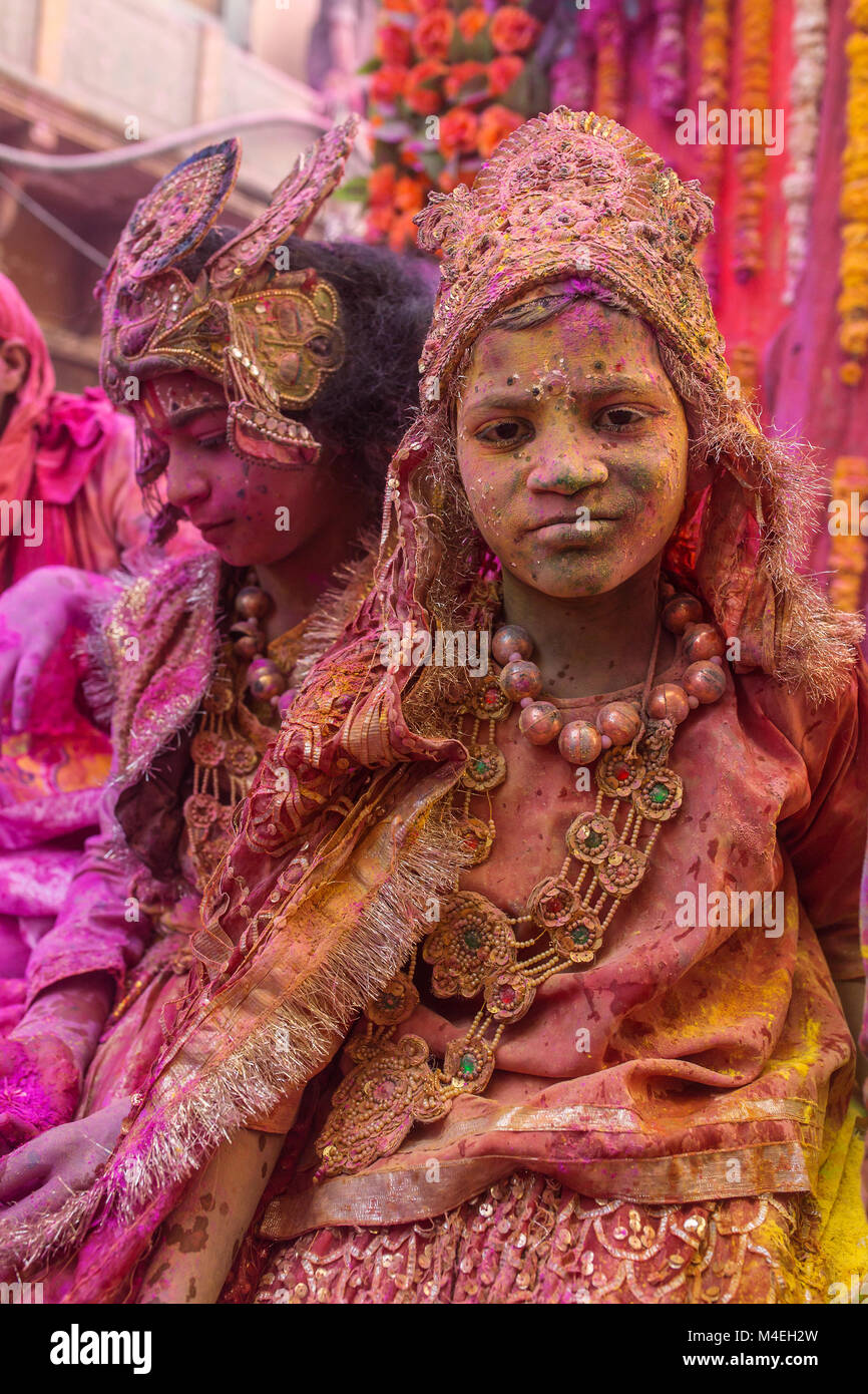 Mathura, India - March 23, 2016: Indian children dressed as Hindu deities participate during colourful Holi procession - Stock Image