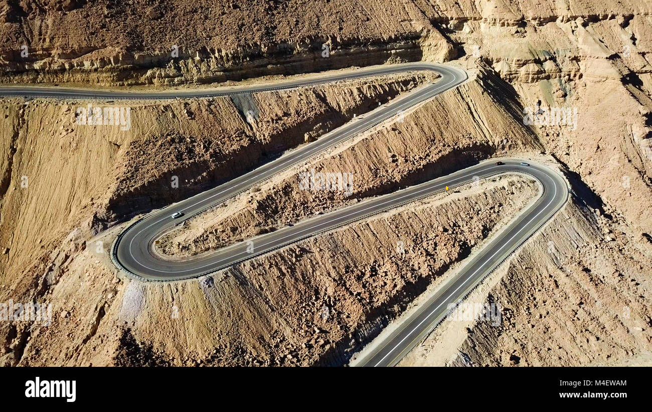 Desert road - Aerial image of traffic going up and down a serpentine mountain road - Stock Image