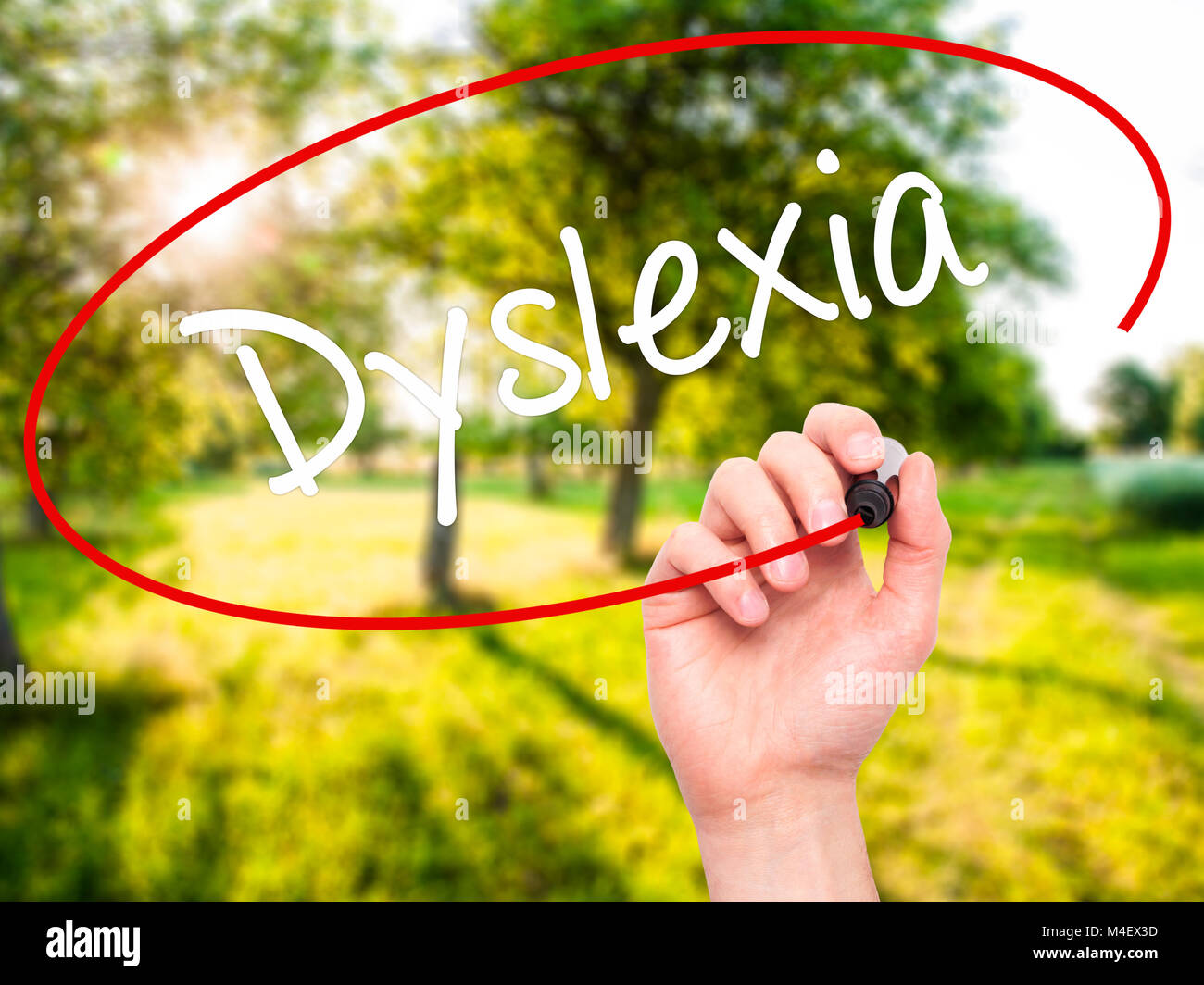 Man Hand writing Dyslexia with black marker on visual screen Stock Photo