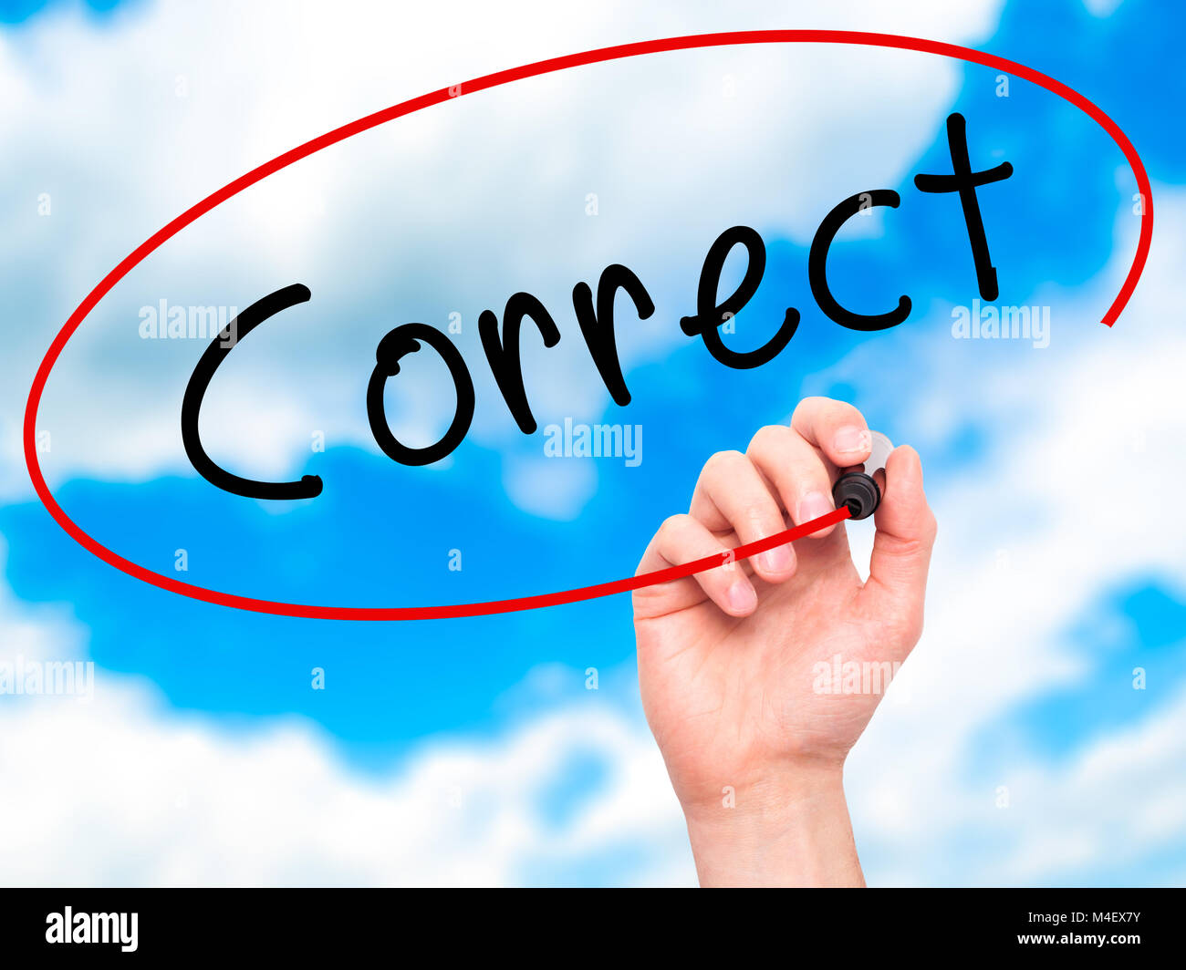 Man Hand writing Correct with black marker on visual screen Stock Photo