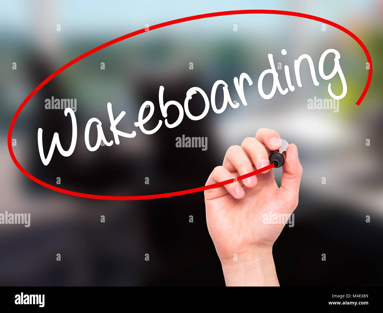 Man Hand writing Wakeboarding with black marker on visual screen. - Stock Image