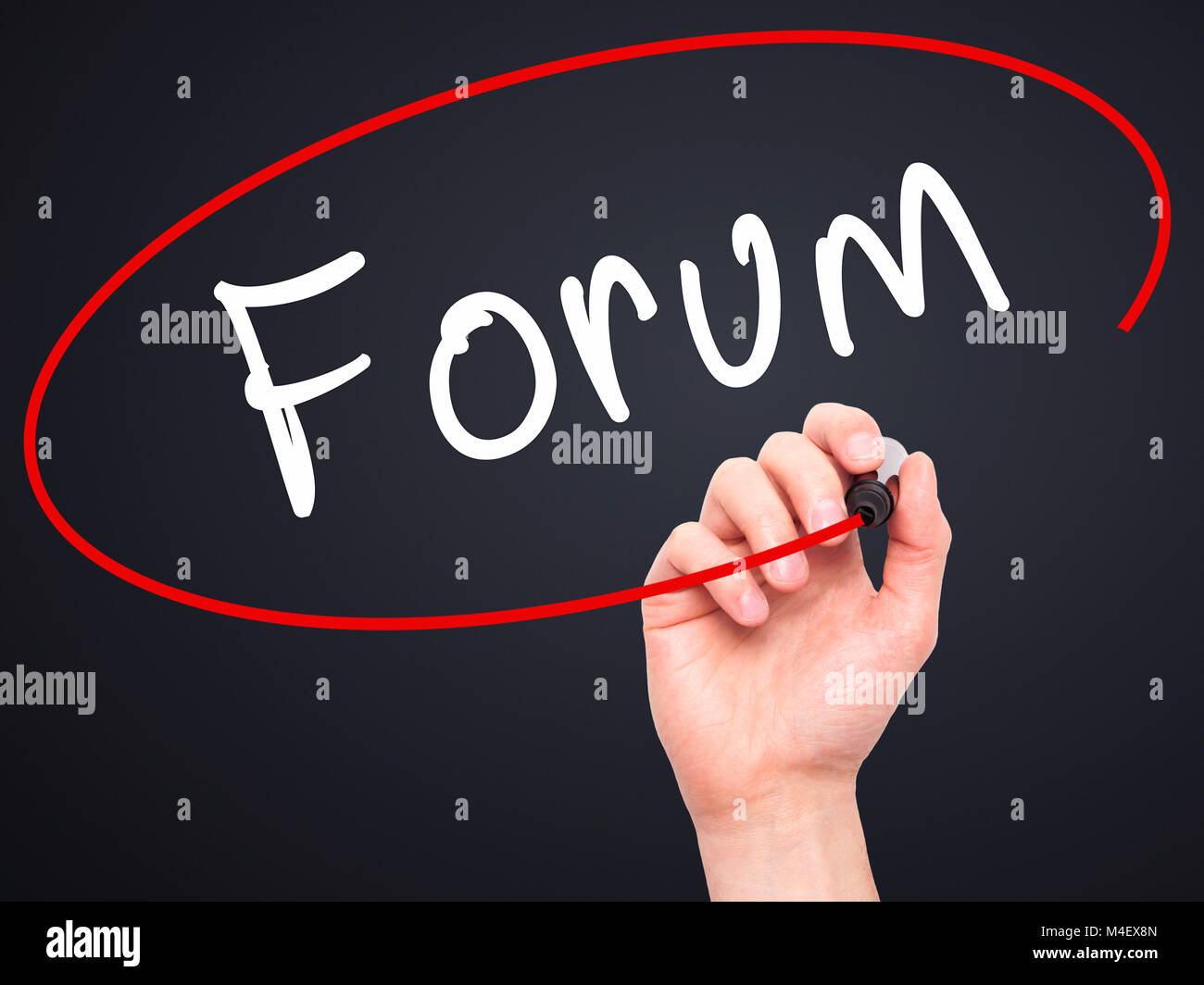 Man Hand writing Forum black marker on visual screen - Stock Image