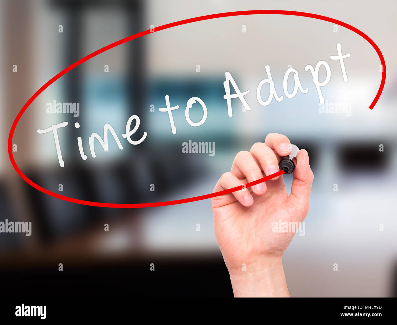 Man hand writing Time to Adapt on visual screen - Stock Image