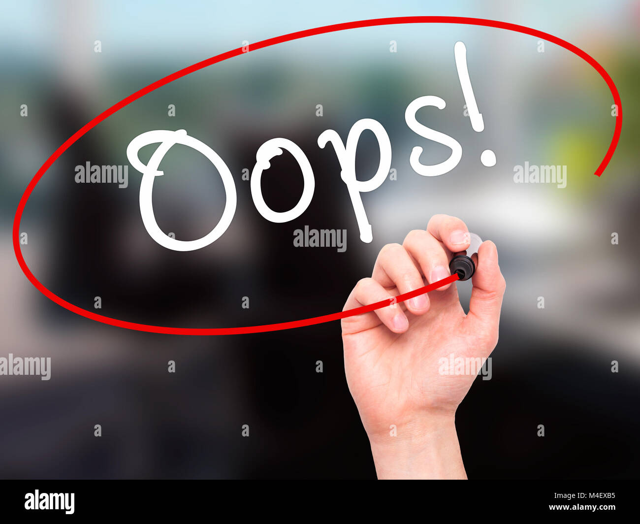 Man Hand writing Oops! with black marker on visual screen - Stock Image