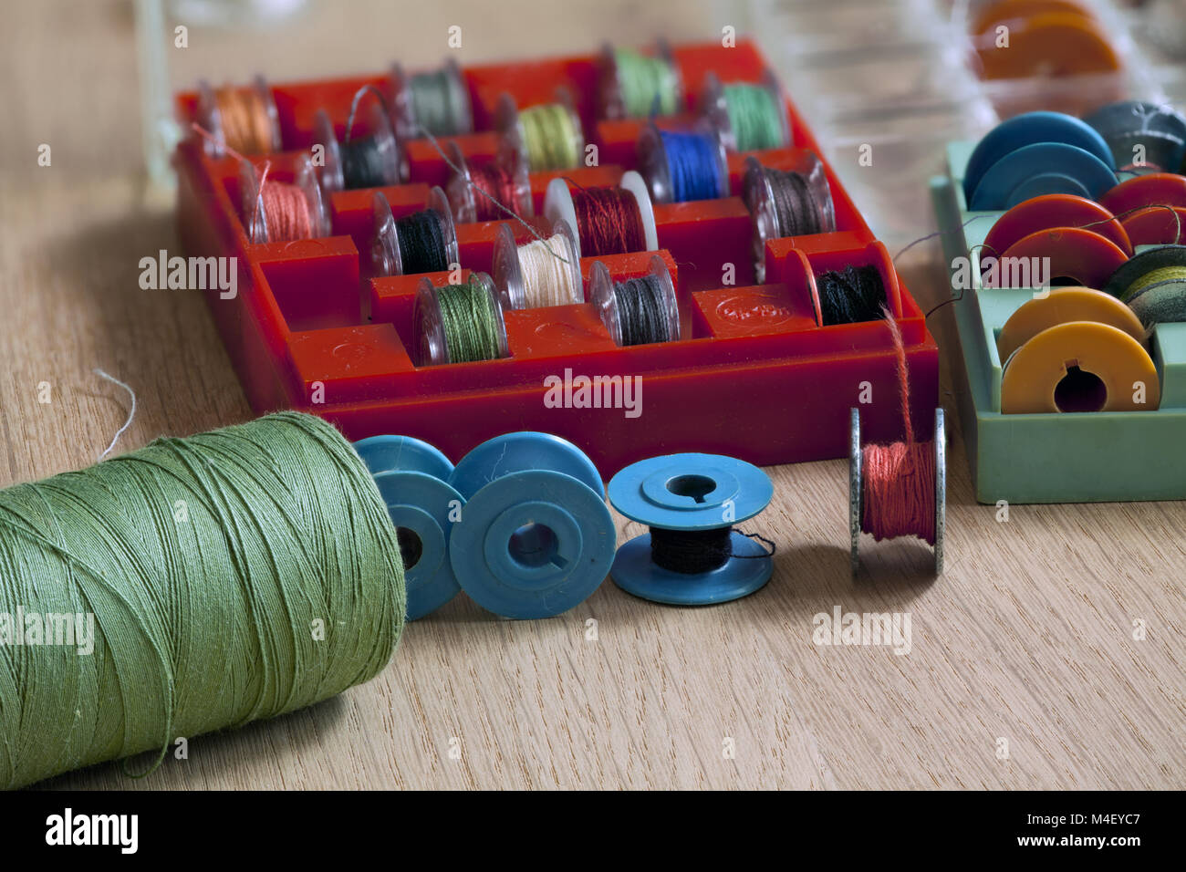 Thread and bobbin for sewing machine - Stock Image