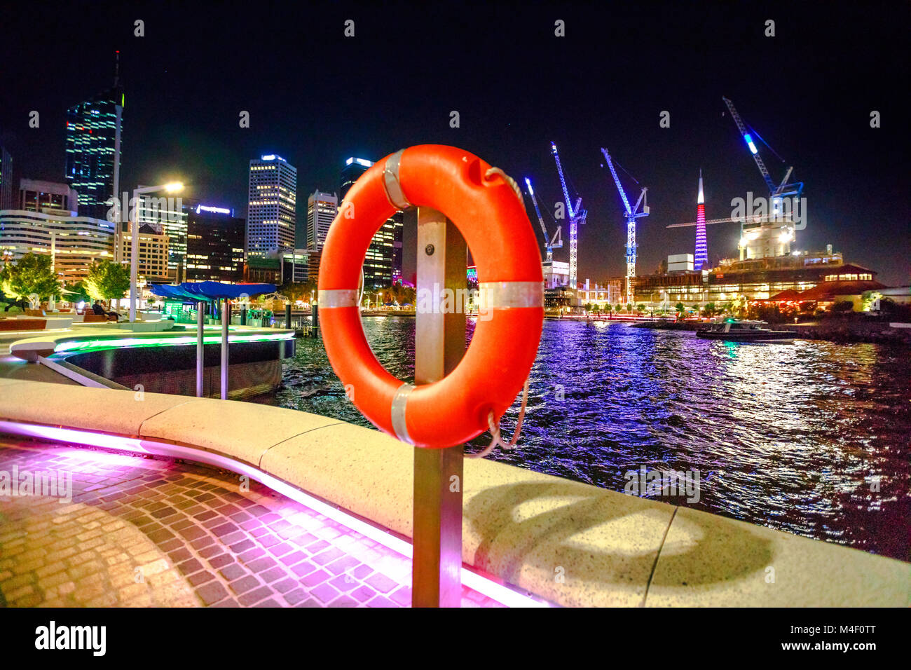 Red life preserver on foreground on walkway of Elizabeth Quay Marina in Perth Downtown, Western Australia. Esplanade Stock Photo
