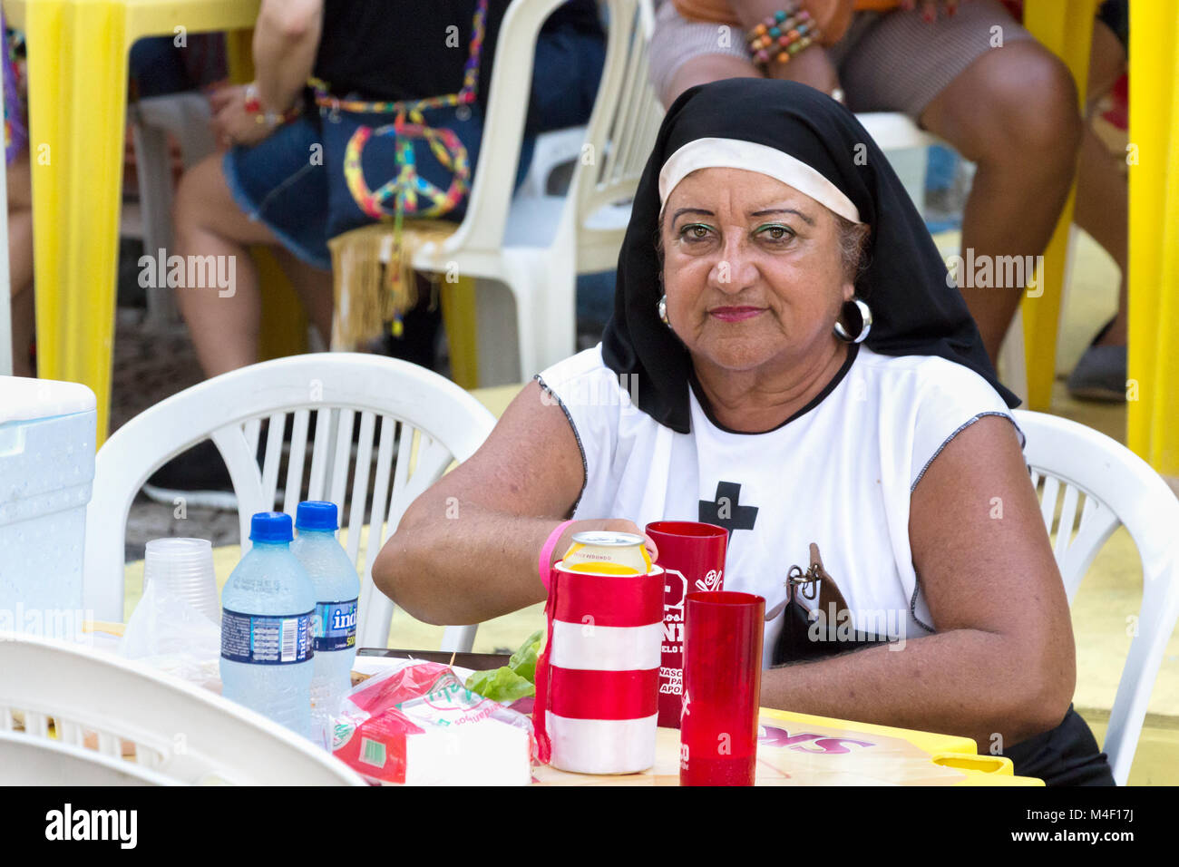 Recife, Brazil - February 9th, 2018: Portrait of a woman with a nun costume at the Carnival in Recife. - Stock Image