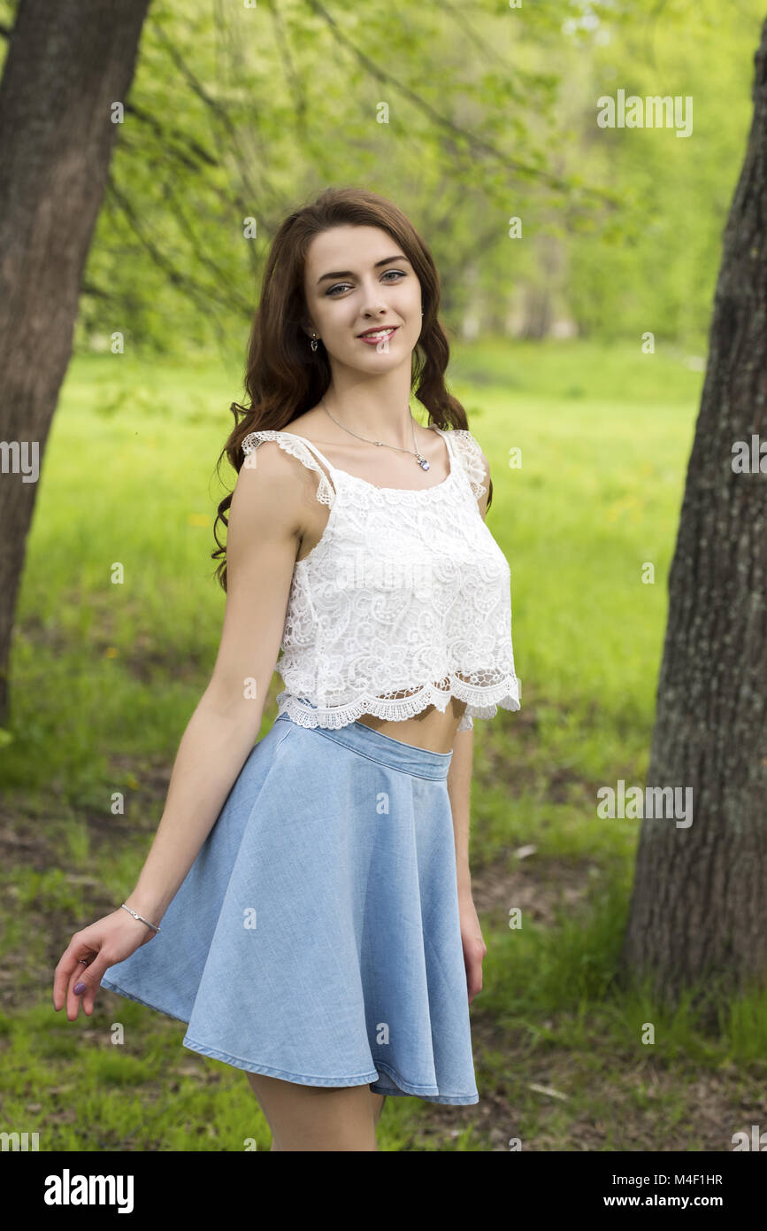 Portrait of a girl with long hair against nature background Stock Photo