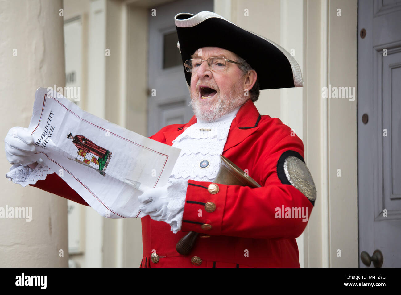 Lichfield Town Crier Ken Knowles calling during the annual pancake race in the centre of Lichfield - Stock Image