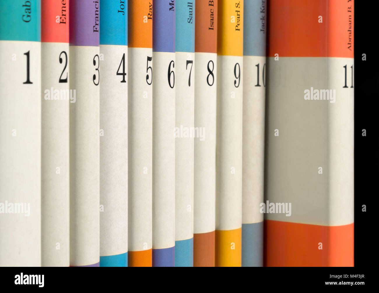 Eleven numbered books in a row - Stock Image