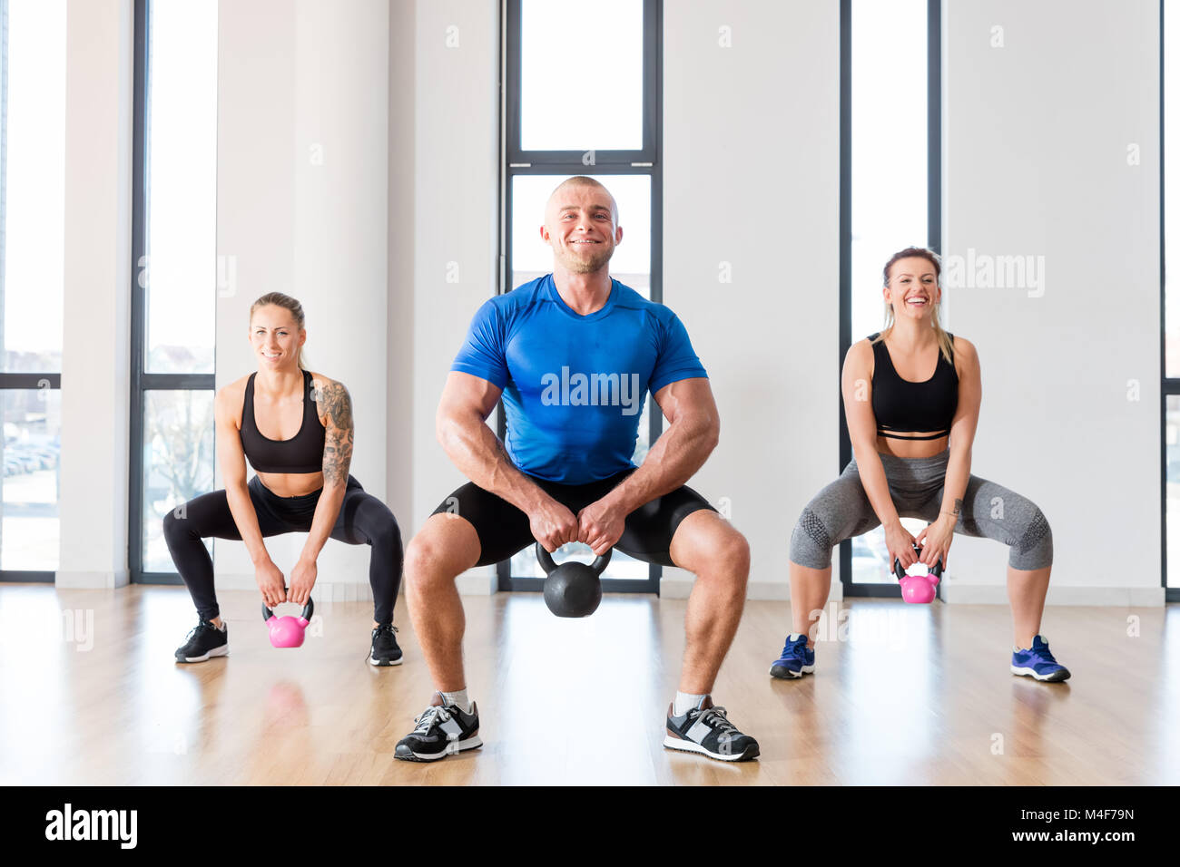 Crossfit group workout with kettlebells. - Stock Image