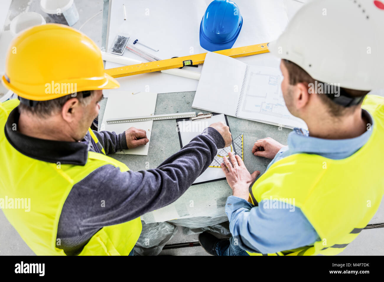 Architect and construction engineer project analysis. - Stock Image