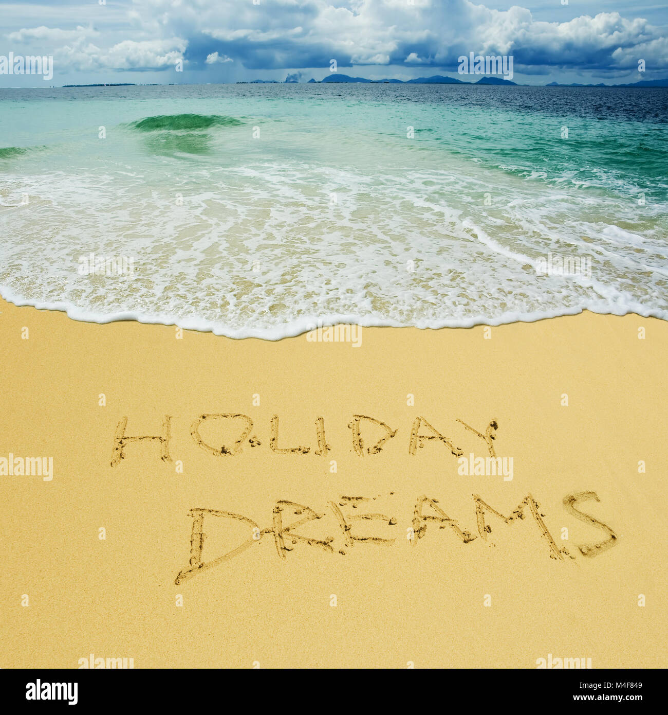 holiday dreams written in a sandy tropical beach - Stock Image