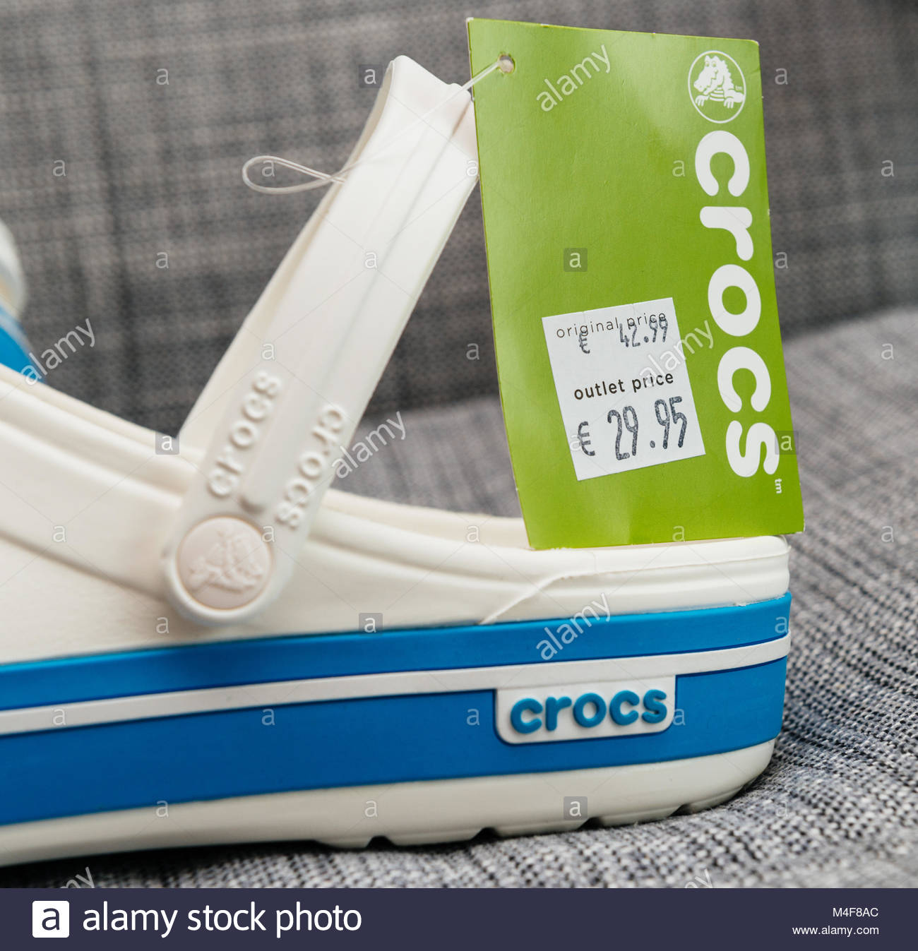 f0f11428f559e8 Crocs clogs shoes with regular and outlet price Stock Photo ...