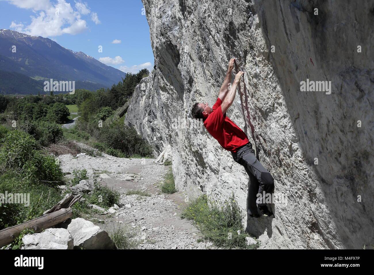 climbing man on rock Stock Photo