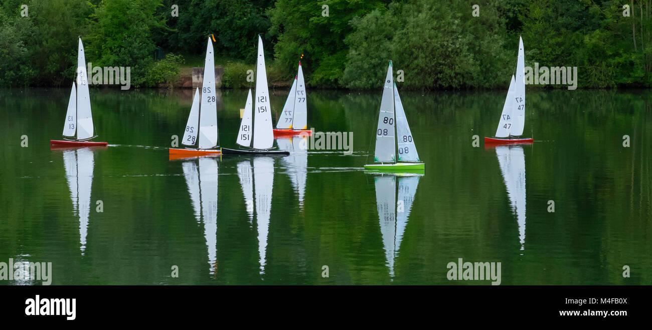Radio controlled racing sailboats. Stock Photo