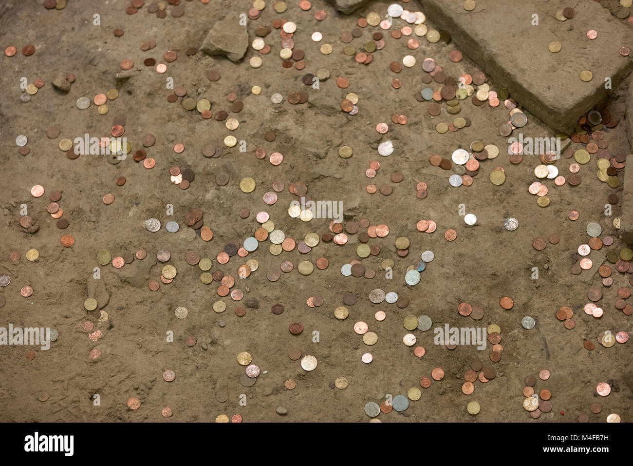Pennies  in the ground - Stock Image