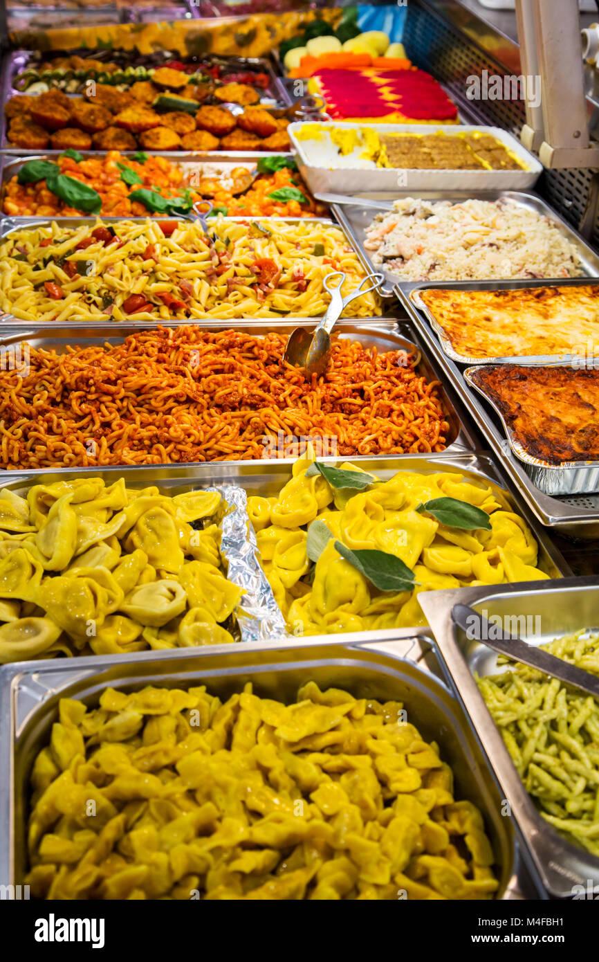 Prepared pasta dishes in Mercato Albinelli in Modena Italy Stock Photo