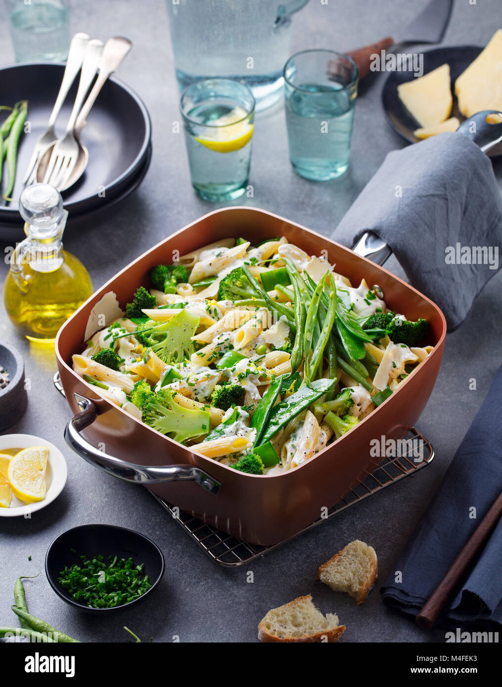 Pasta with green vegetables and creamy sauce - Stock Image