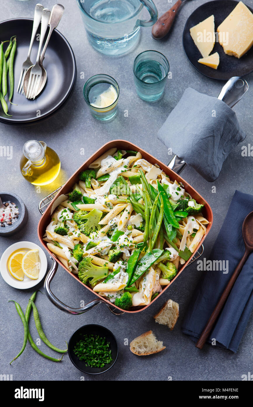Pasta with green vegetables, creamy sauce Top view - Stock Image