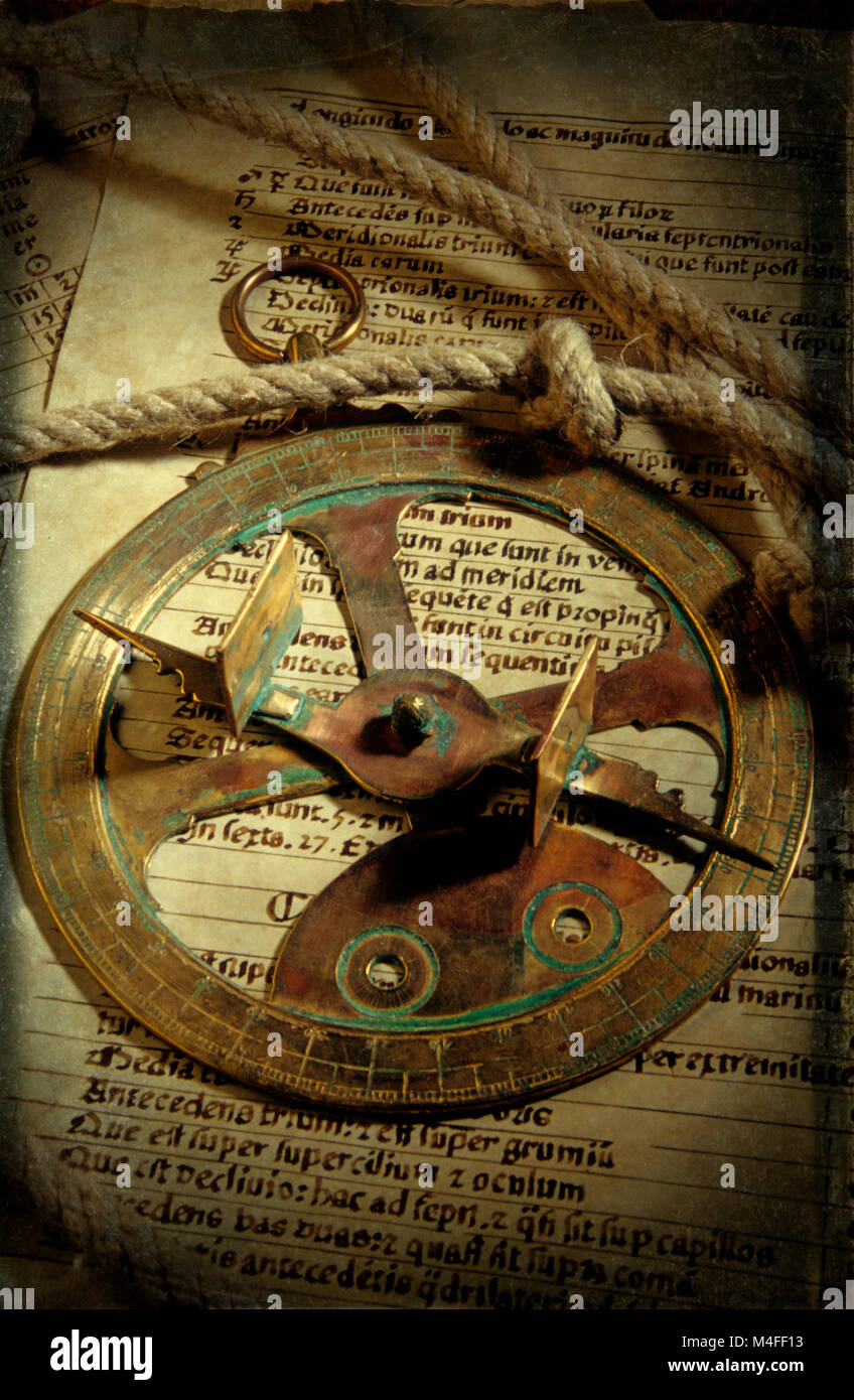 Historical navigation , sailing discovery - Antique sextant , sun dial on a chart log with rope - Stock Image