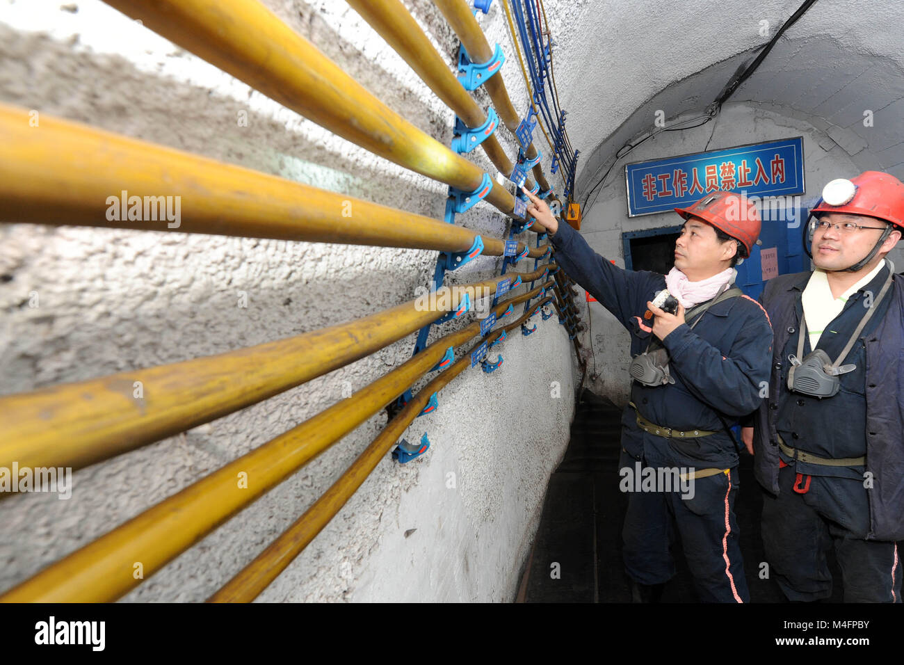 Huaibei, China's Anhui Province. 16th Feb, 2018. Miners check the security of a 560-meter-deep underground mine - Stock Image