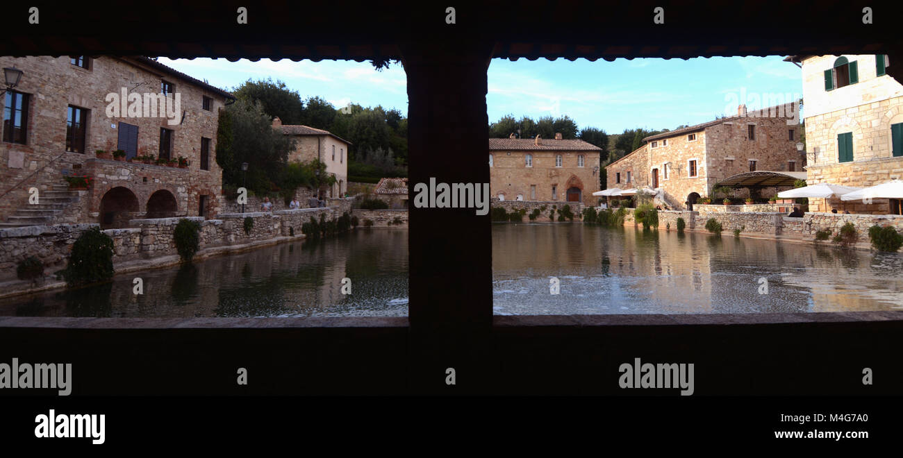 Bagno Vignoni is a village in the district of San Quirico d'Orcia in the province of Siena in Val d'Orcia.Its square Stock Photo
